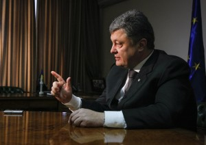 Petro Poroshenko gestures during an interview with Reuters in Kiev