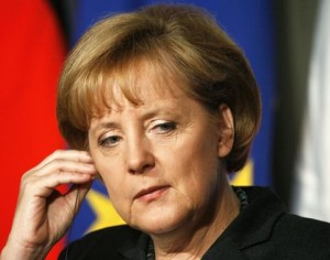 Germany's Chancellor Angela Merkel listens to a question at a joint news conference in Trieste